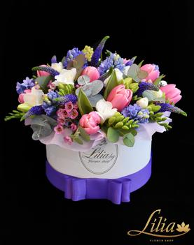 Stylish box with spring flowers.